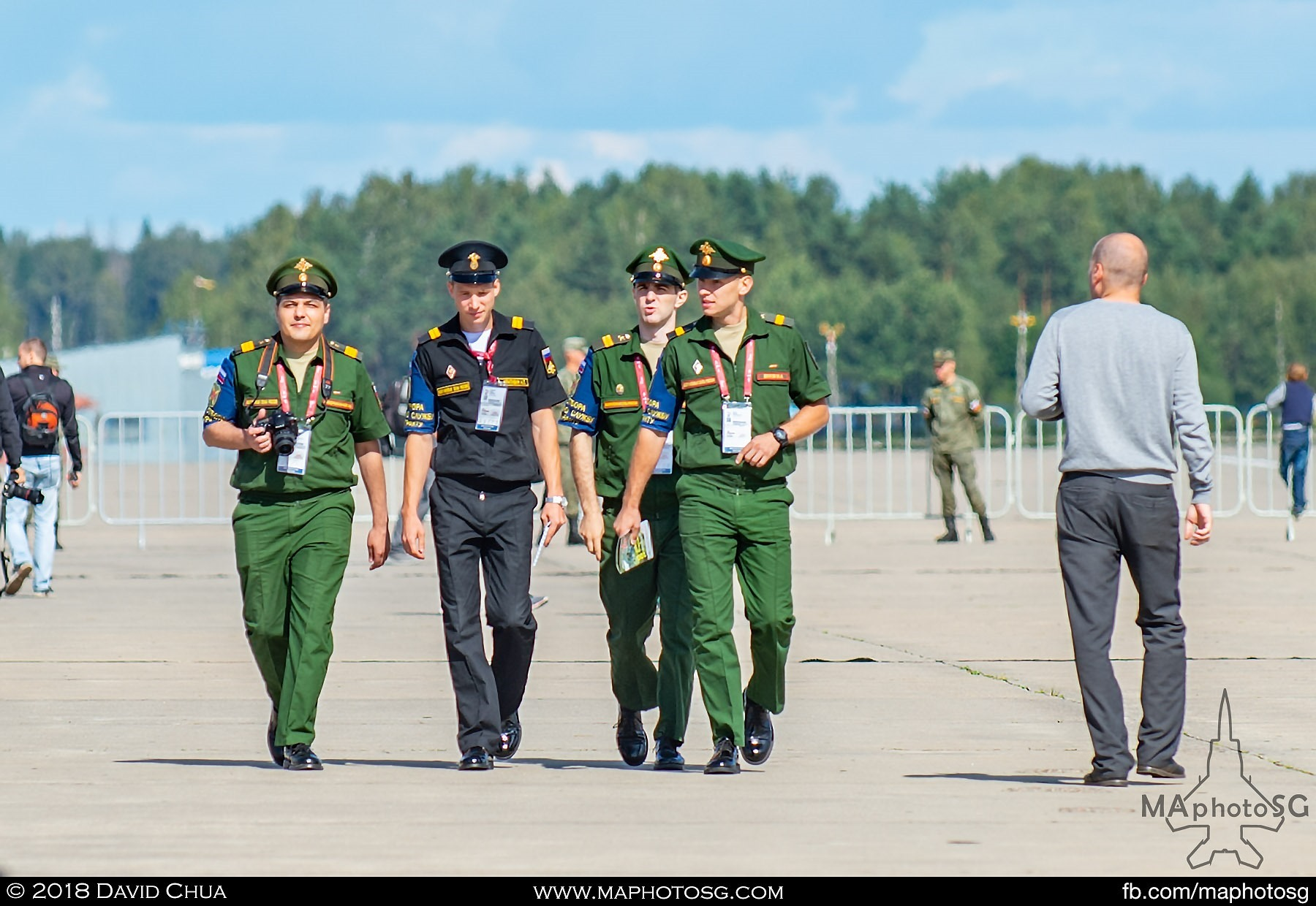 30. Base personnel in Kubinka Airfield going around taking pictures of the event