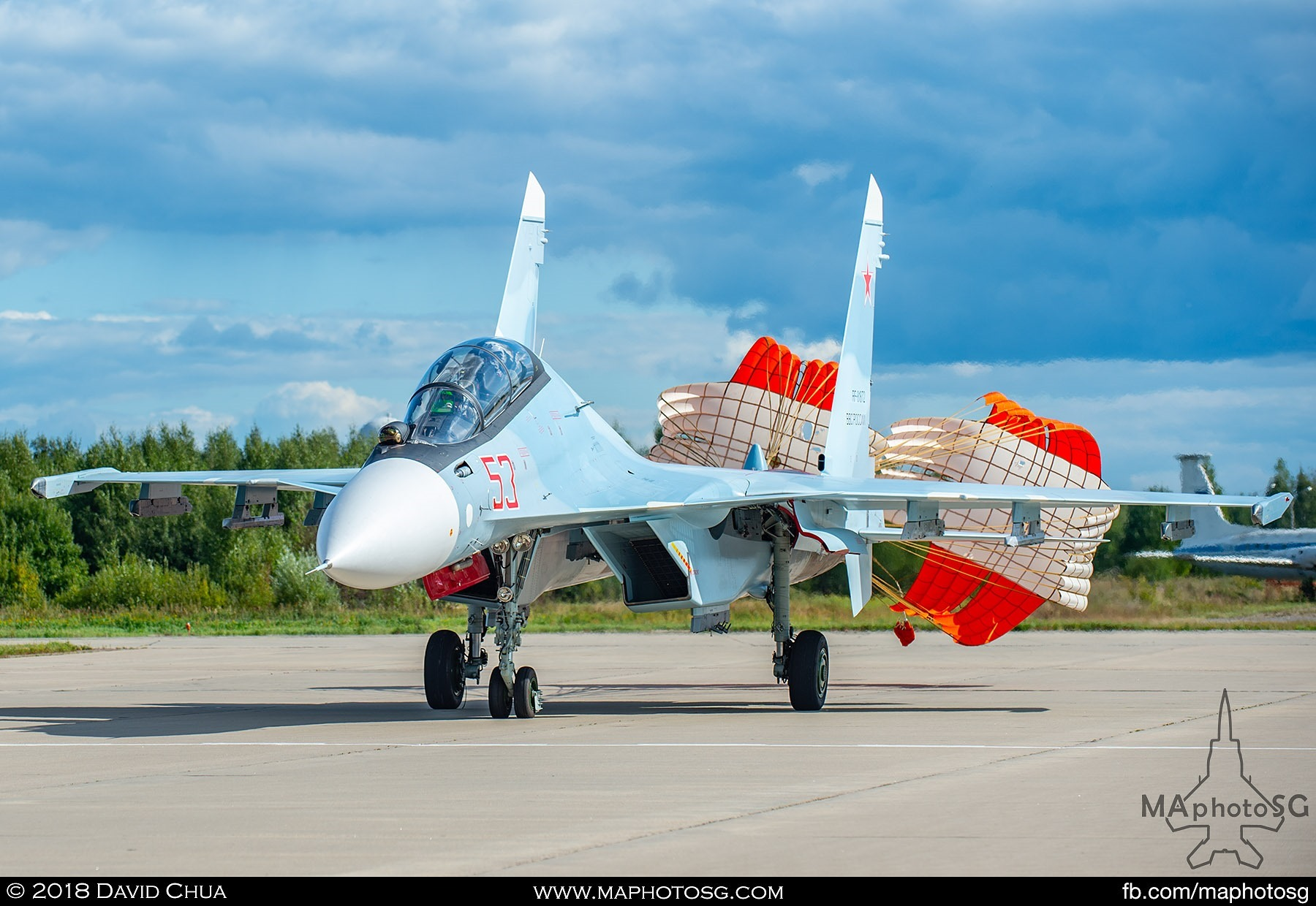 "42. Chutes deployed as the Su-30sm ""Flanker"" turns of the runway after landing"