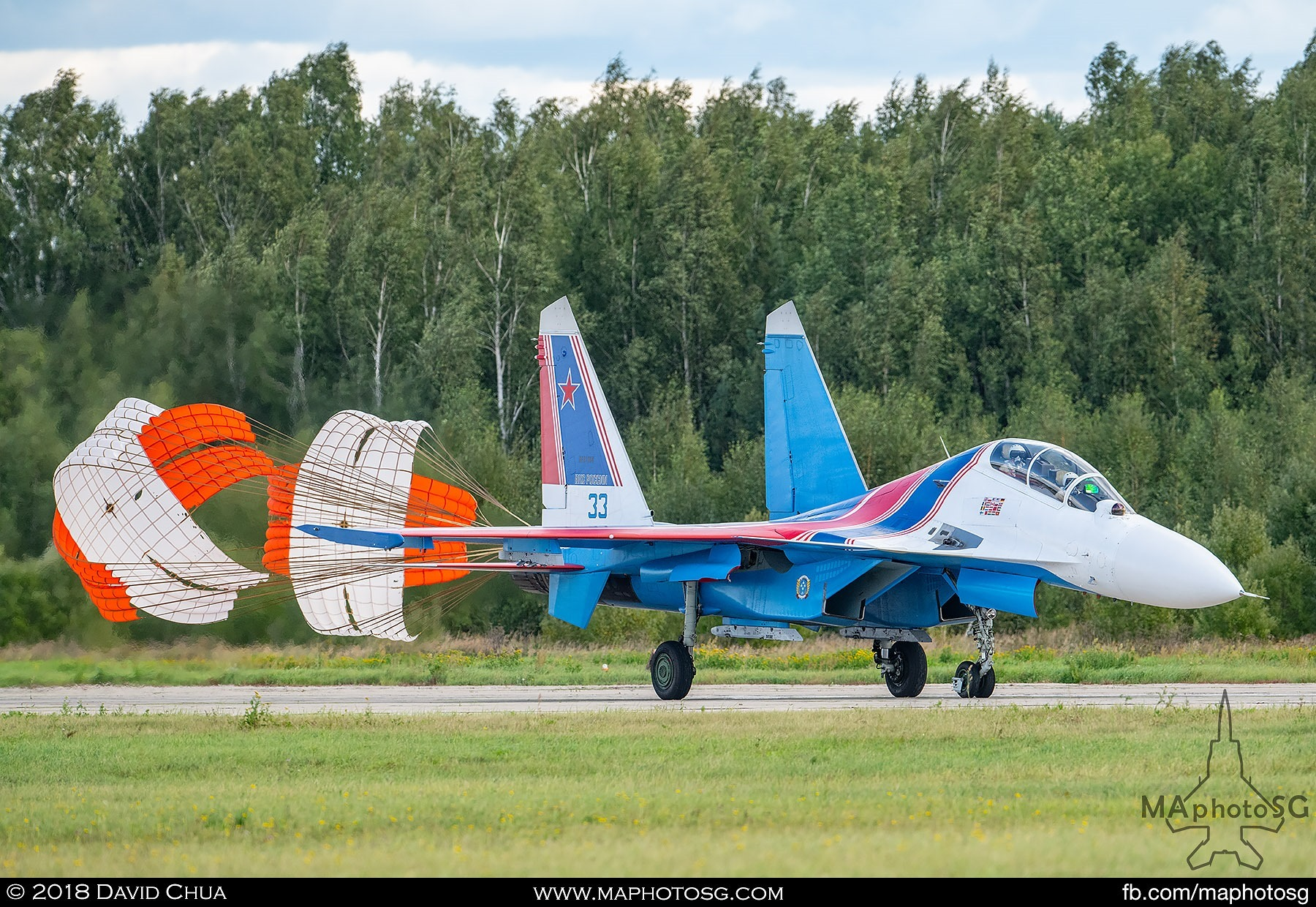 "49. A Russian Knights Su-27sm ""Flanker"" lands on the runway as they complete their aerial display performance."