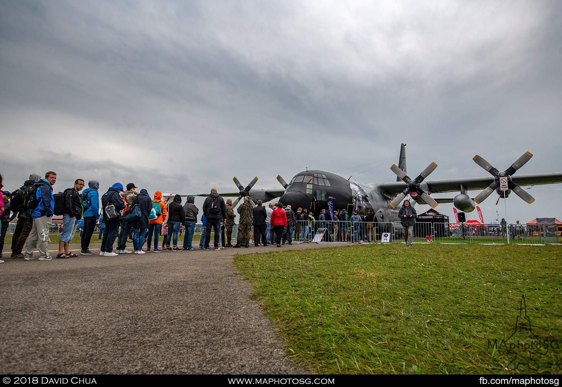 11. Long line of the queue for a closer look inside the Belgium Air Force C-130H Hercules with special livery