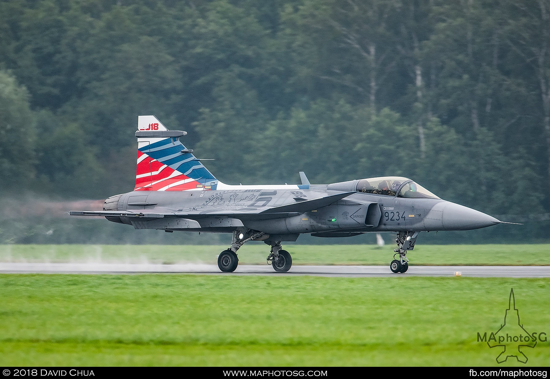 31. Czech Air Force Jas-39C Gripen thunders down the wet runway in front of the crowd