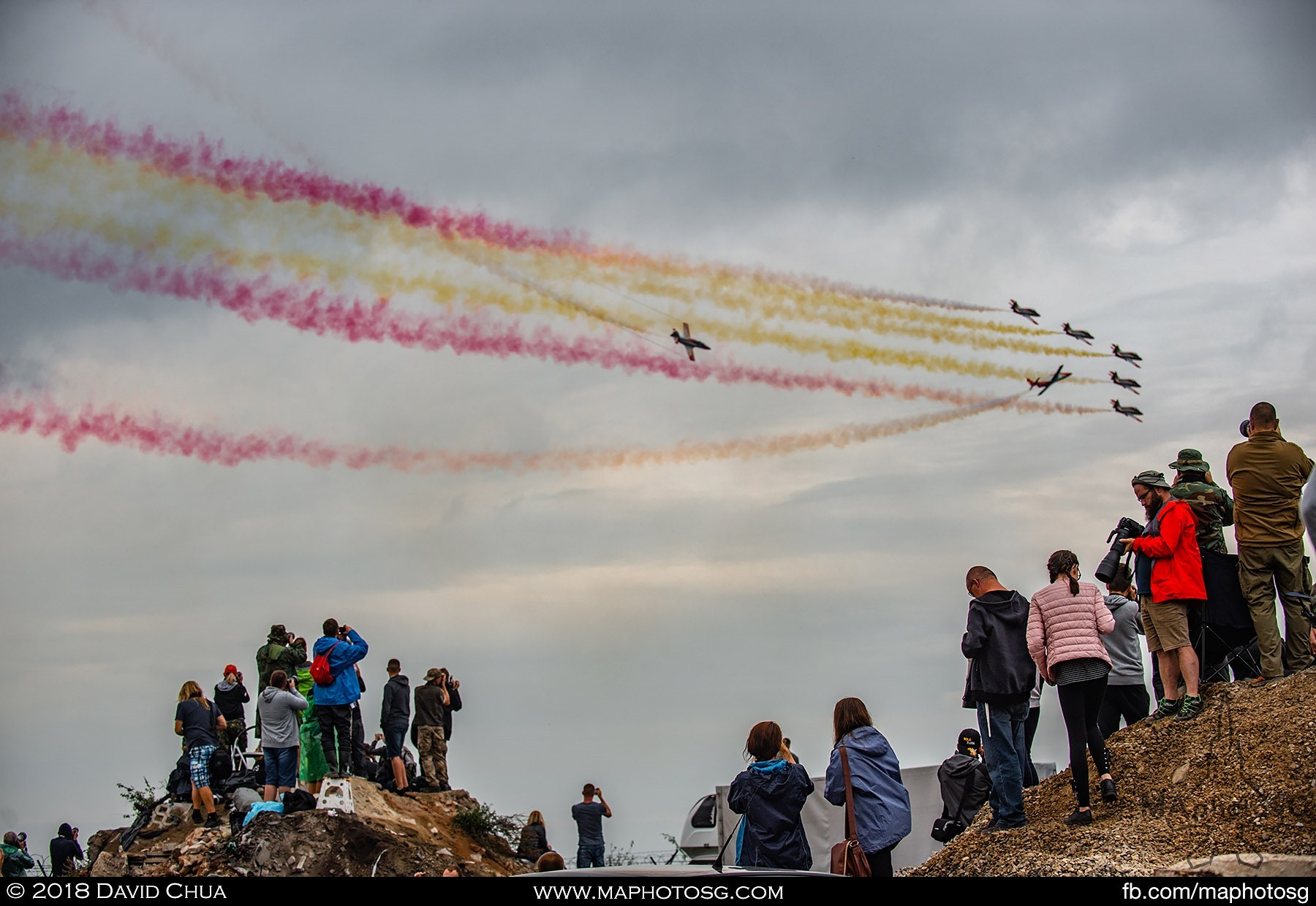 36. Crowd on the opposite side of the runway catches the Spanish Air Force Patrulla Águila performance