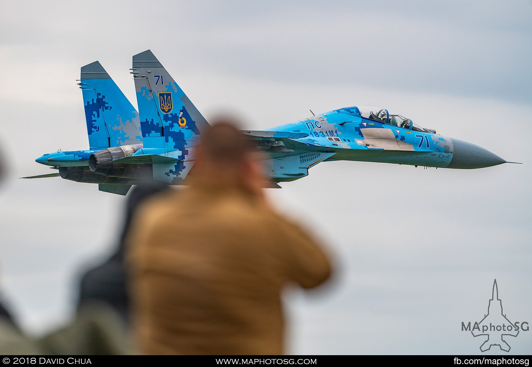 44. Photographers tries to capture the Ukrainian Air Force Su-27 Flaker as it performed a low pass