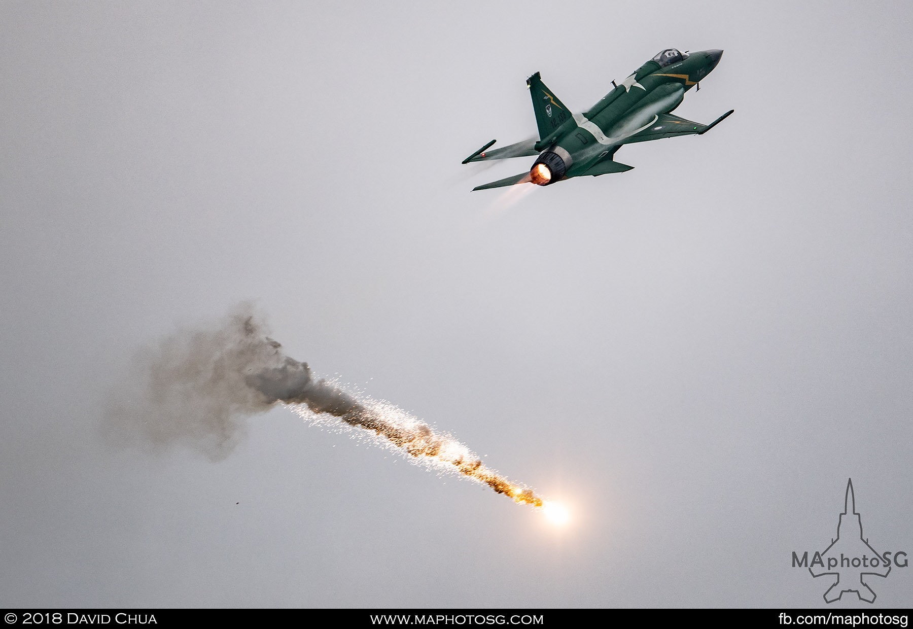 48. Pakistani Air Force JF-17 Thunder dispenses flares as part of its display