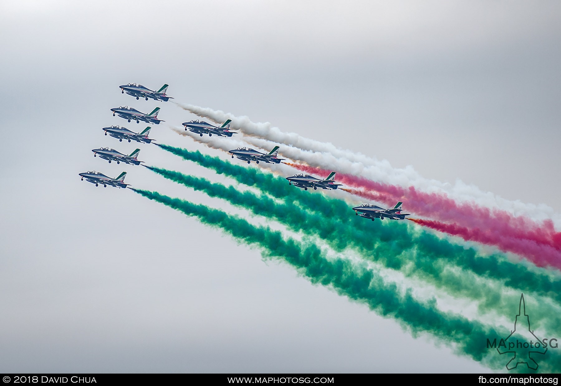 57. Frecce Tricolori flying in formation and painting the sky with the green white and red of the Italian Flag